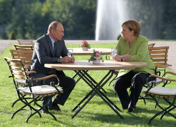 """""""Reuters""""/""""Scanpix"""" nuotr./A.Merkel ir V.Putino susitikimas prie Berlyno"""
