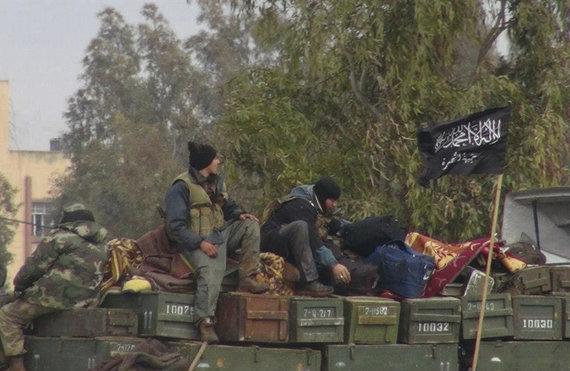 """Scanpix""/AP nuotr./""Al Nusros fronto"" kovotojai Sirijoje"
