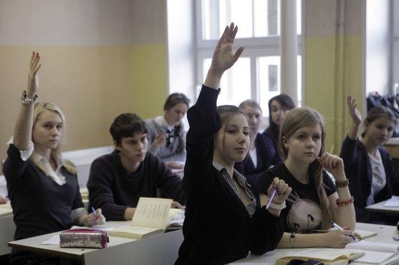 """""""Reuters""""/""""Scanpix"""" nuotr./Vaikai vienoje Rygos mokykloje"""