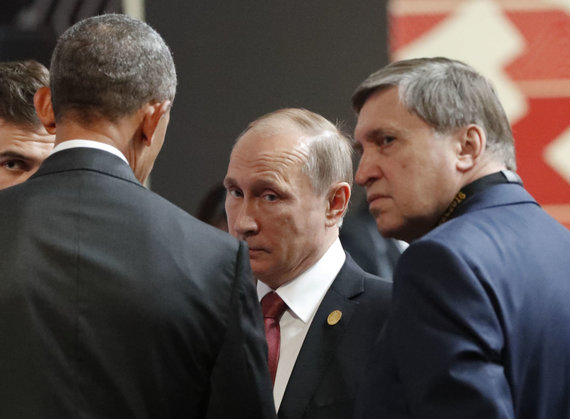 "AFP/""Scanpix"" nuotr./Vladimiras Putinas ir Jurijus Ušakovas"