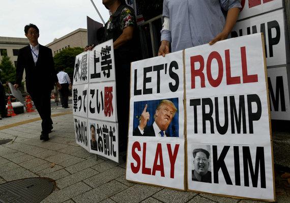"""AFP/""""Scanpix"""" nuotr./Donaldo Trumpo ir Kim Jong Uno susitikimas"""