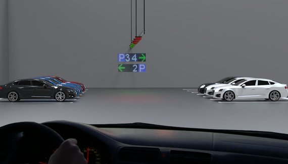 Car parking guidance system in an indoor parking lot with TOF sensors. A single sensor monitors the use of two parking spaces on opposite sides and transmits it to the Parksol system.
