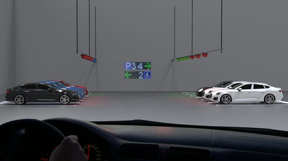 Car parking guidance system in an indoor parking lot with TOF sensors. A single sensor monitors the use of a single parking space and transmits it to the Parksol system.
