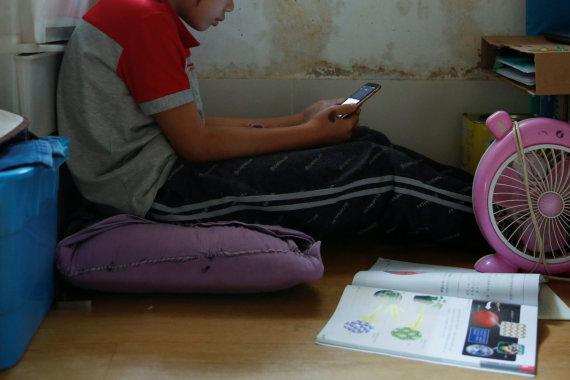 """""""Reuters""""/""""Scanpix"""" nuotr./Honkongiečiai masiškai dirba iš namų"""
