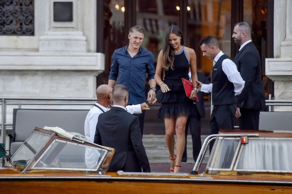 """Scanpix""/Xposurephotos.com nuotr./Bastianas Schweinsteigeris ir Ana Ivanovič"
