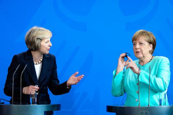 """""""Scanpix""""/""""Xinhua""""/""""Sipa USA"""" nuotr./Theresa May ir Angela Merkel"""