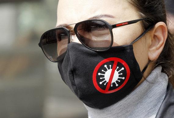 """AFP/""""Scanpix"""" nuotr./Apsauginė kaukė"""