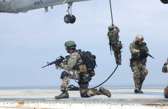 """""""Scanpix""""/""""SIPA"""" nuotr./JAV specialiųjų pajėgų kariai"""