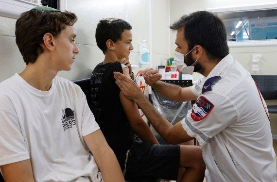 "AFP/""Scanpix"" nuotr./Izraelyje skubama skiepyti vaikus"