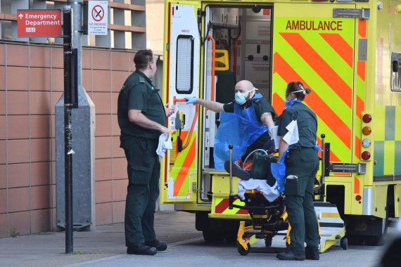"""AFP/""""Scanpix"""" nuotr./Jungtinė Karalystė per koronaviruso pandemiją"""