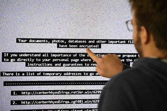 """AFP/""""Scanpix"""" nuotr./Išpirkos reikalaujančio viruso grasinimai"""