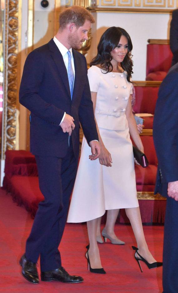 """""""Scanpix""""/""""PA Wire""""/""""Press Association Images"""" nuotr./Princas Harry ir Sasekso hecogienė Meghan"""