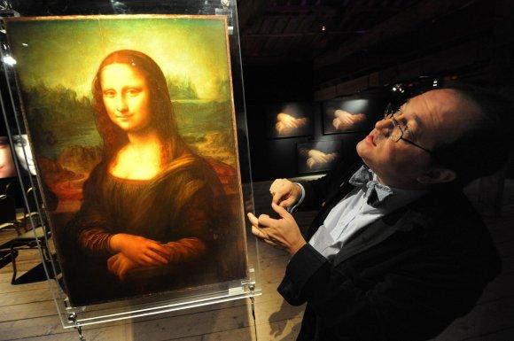 "Scanpix nuotr./Pascalis Cotte'as ir ""Mona Lisa"""