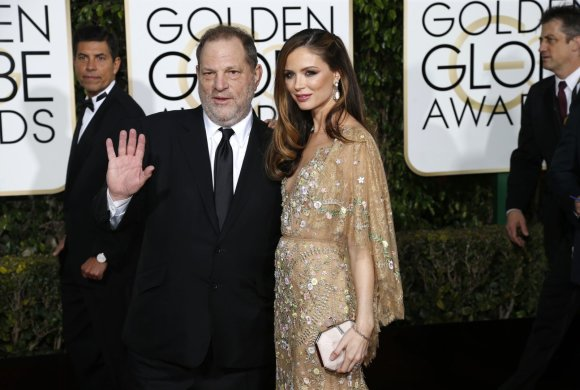 """Reuters""/""Scanpix"" nuotr./Harvey Weinsteinas su žmona Georgina Chapman"