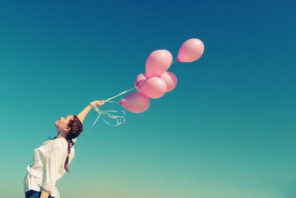 Fotolia nuotr./Moteris ir balionai