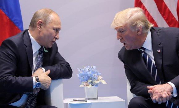 """""""Reuters""""/""""Scanpix"""" nuotr./Vladimiro Putino ir Donaldo Trumpo susitikimas"""