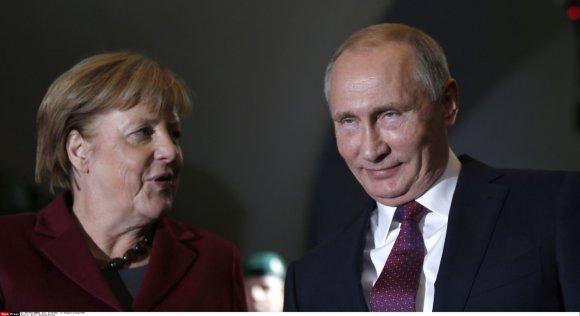 """""""Scanpix""""/""""Sipa USA"""" nuotr./Angela Merkel ir Vladimiras Putinas Berlyne"""