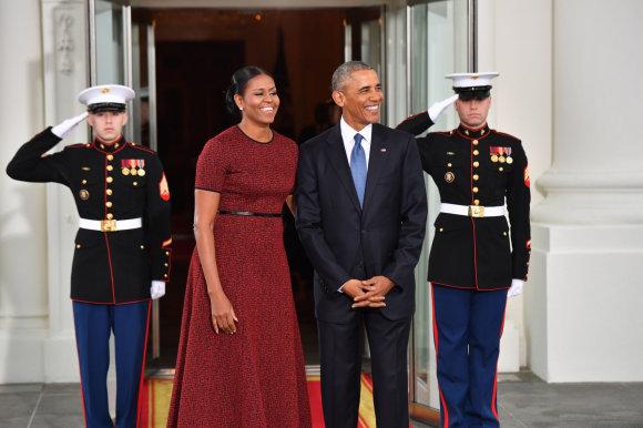 """Scanpix""/""Sipa USA"" nuotr./Michelle Obama ir Barackas Obama"