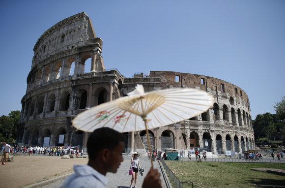 """""""Reuters""""/""""Scanpix"""" nuotr./Kinas prekeivis Romoje"""