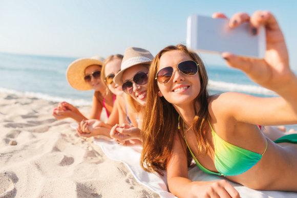 123rf.com nuotr./Nuotraukos iš paplūdimio – vienos dažniausių, kuriomis dalinamės socialiniuose tinkluose