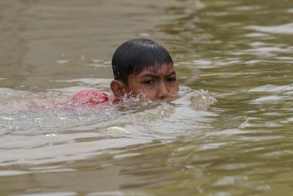 """AFP/""""Scanpix"""" nuotr./Tailandą siaubia potvyniai"""