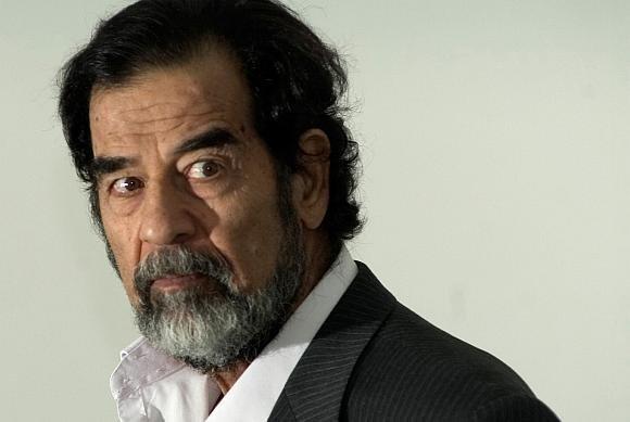 """AFP/""""Scanpix"""" nuotr./Užsitarnauti Saddamo Husseino pasitikėjimą nebuvo lengvas darbas."""