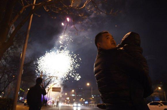 """AFP/""""Scanpix"""" nuotr./Avies metų sutiktuvės Kinijoje"""