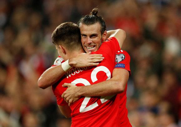 """Scanpix"" nuotr./Benjaminas Woodburnas ir Garethas Bale'as"