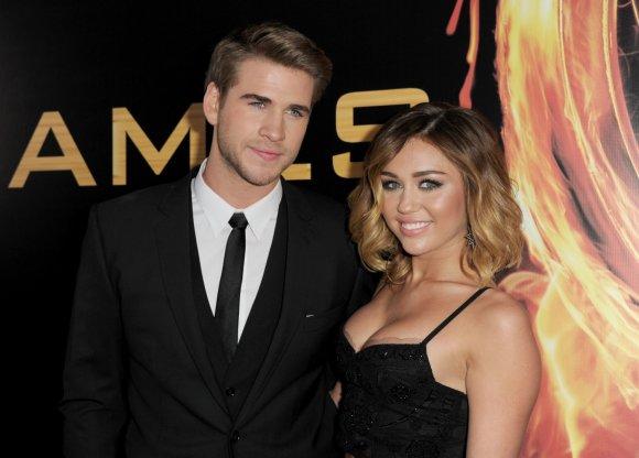 """Reuters""/""Scanpix"" nuotr./Liamas Hemsworthas ir Miley Cyrus"