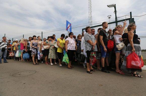 """""""Scanpix""""/""""Reuters"""", AFP nuotr./Ukrainiečių pabėgėlių stovykla šalia Rusijos Donecko miesto"""
