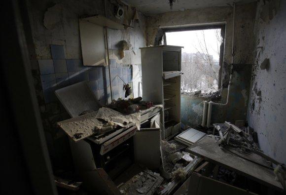 """AFP/""""Scanpix"""" nuotr./Per miestą eina fronto linija"""