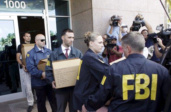 """""""Reuters""""/""""Scanpix"""" nuotr./Atliktos kratos FIFA padalinio būstinėje Floridoje"""