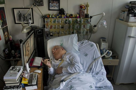 """AFP/""""Scanpix"""" nuotr./Nuo metukų paralyžiuotas brazilas kuria animacinį filmuką vaikams"""