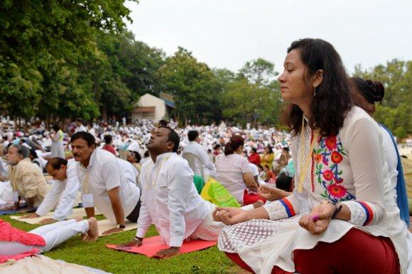 "AFP/""Scanpix"" nuotr./Visame pasaulyje praktikuojama joga"