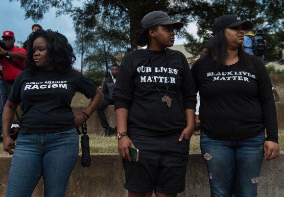 """AFP/""""Scanpix"""" nuotr./Kitur Vakaruose manoma, kad JAV egzistuoja rasinė diskriminacija"""