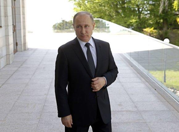 """""""Scanpix""""/AP nuotr./Angelos Merkel ir Vladimiro Putino susitikimas Sočyje"""