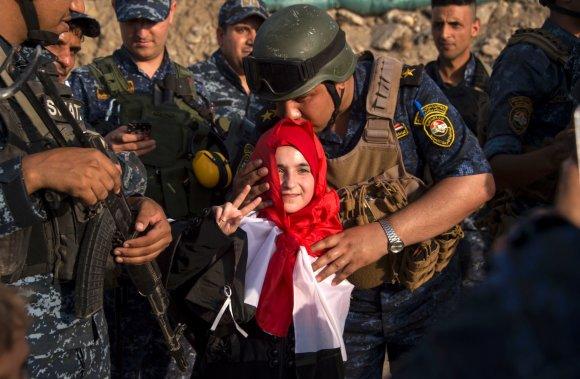 "AFP/""Scanpix"" nuotr./Irako kariai išlaisvintame Mosule"