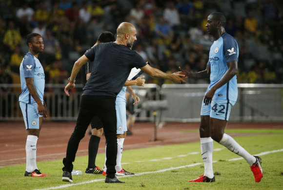 """Reuters""/""Scanpix"" nuotr./Pepas Guardiola ir Yaya Toure"