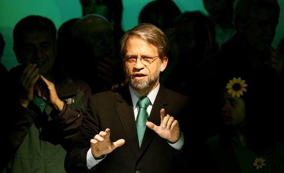 """""""Scanpix"""" nuotr./J.M.Santosas pakeis dvi kadencijas baigusį prezidentą Alvaro Uribe"""