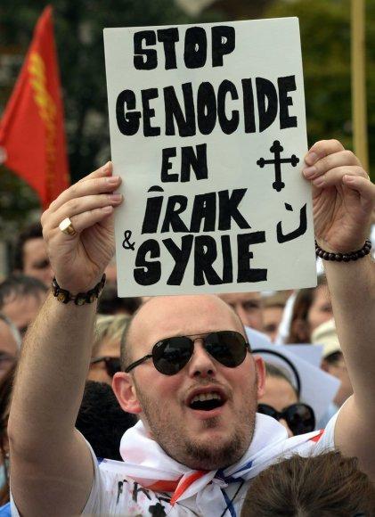 Protesto prieš krikščionių žudymą Irake ir Sirijoje dalyvis