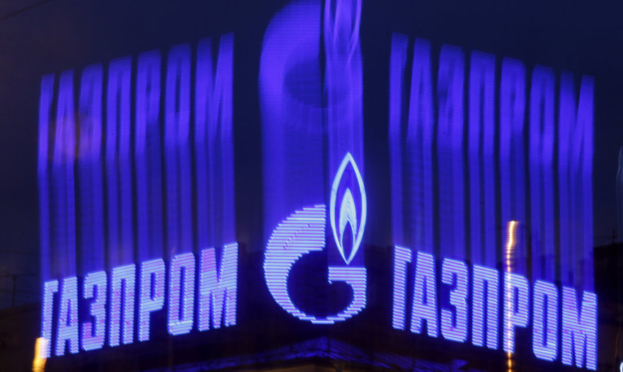 The company logo of Russian natural gas producer Gazprom is seen on an advertisement installed on the roof of a building in St. Petersburg in this November 14, 2013 file photo. As bankers, traders and investors gathered at Gazprom's London offices for its annual champagne reception, the message from