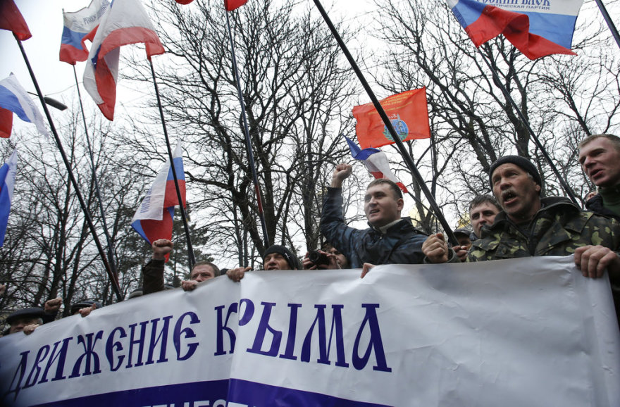 People hold flags during a pro-Russian rally outside the Crimean parliament building in Simferopol February 27, 2014. Armed men seized the regional government headquarters and parliament on Ukraine's Crimea peninsula on Thursday and raised the Russian flag in a challenge to the country's new rulers.