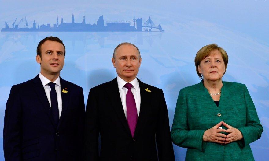 """Reuters""/""Scanpix"" nuotr./Emmanuelis Macronas, Vladimiras Putinas, Angela Merkel"