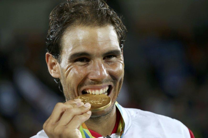 Dvejetų turnyro nugalėtojams įteikti olimpiniai medaliai