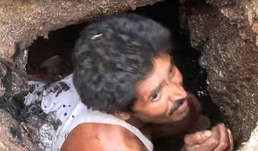Indijos kanalizacijos valytojas