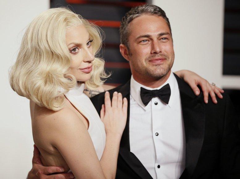"""Reuters""/""Scanpix"" nuotr./Lady Gaga ir Tayloras Kinney"