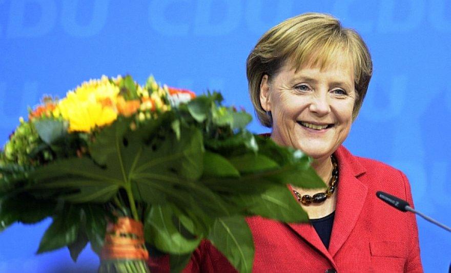Angela Merkel švenčia pergalę.