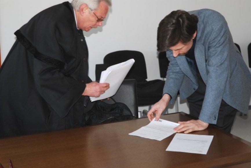 G.Gedminas su advokatu