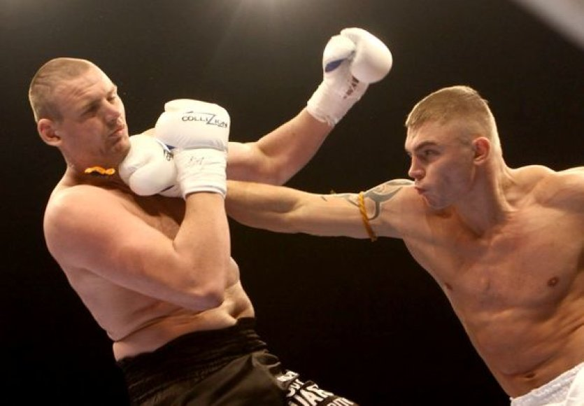 S.Maslobojevas (dešinėje) 145 kg sveriantį rumuną V.Popovičių nokautavo per 11 sekundžių
