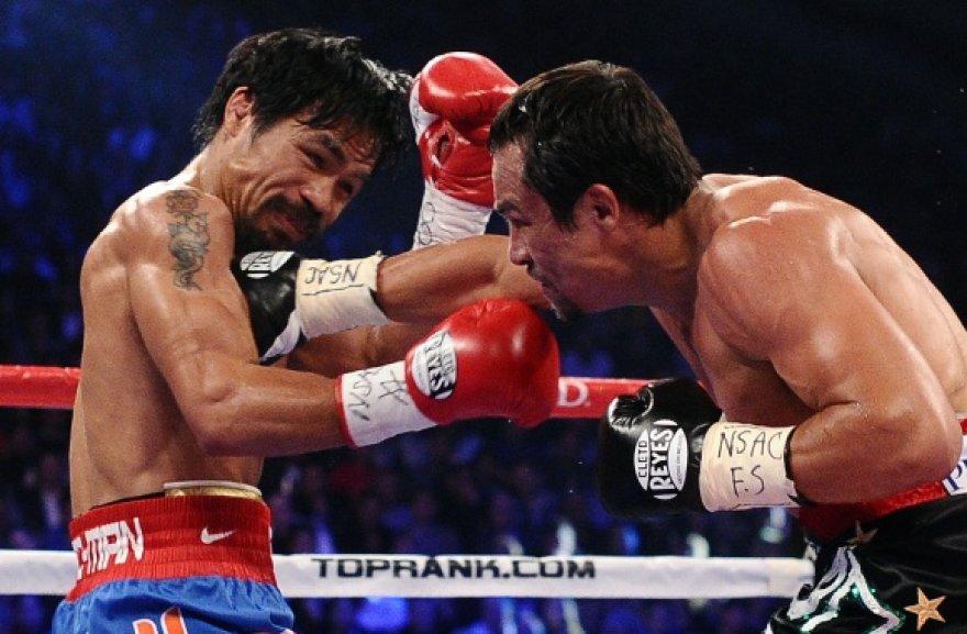 Manny Pacquiao (kairėje) prieš Juaną Manuelį Marquezą.